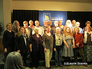 In the front row, Susan Gagnon is third from the left, and Claire Hersom is fourth from the left.