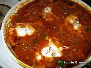 Eggs simmering in sauce
