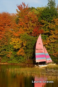 Colorful boat by colorful leaves on Maranacook Lake