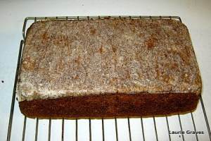 Upside down pumpkin bread with parchment paper on the bottom