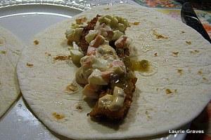 A fish taco, ready to be eaten