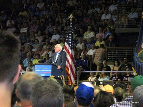 Sanders speaking before the crowd