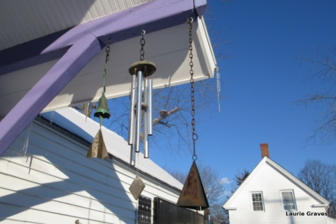 Wind chimes against blue